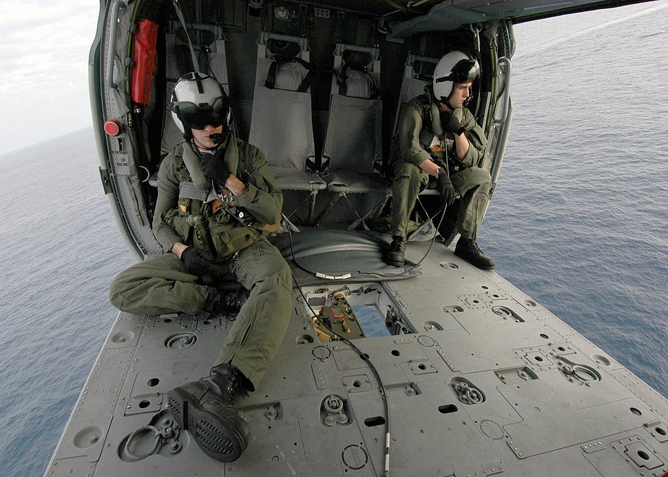 US Navy 040423-N-4190W-001 Search and Rescue Swimmer (SAR) members sit in a MH-60s Knighthawk helicopter during an vertical replenishment