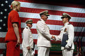 US Navy 040508-N-2383B-351 Adm. Vern Clark, Chief of Naval Operations (CNO) congratulates Ensign Douglas Murph, of Union Bridge, Md., as one of over forty graduates receiving his commission.jpg