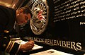 US Navy 041202-N-3659B-001 Lt. Cmdr. Samuel Delgado, Navy Recruiting's 2004 Reserve Diversity Recruiter of the Year, signs a visitor book at the September 11th Memorial in the Pentagon.jpg