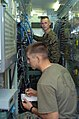 US Navy 050112-N-8252B-020 Lance Cpl. Aaron Carlson and Sgt. Matthew Jobe man a telephone switchboard in Utapao, Thailand.jpg
