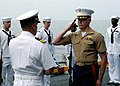 US Navy 050730-N-3666S-104 Cmdr. Steven Halpern receives the ensign from Maj. David Williams during one of three burial at sea ceremonies conducted aboard the amphibious assault ship USS Wasp (LHD 1).jpg
