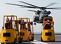 US Navy 050913-N-0535P-073 Sailors manning forklifts prepare to load supplies into an MH-53 Sea Dragon helicopter on the flight deck aboard USS Harry S. Truman (CVN 75) in support of hurricane relief efforts.jpg