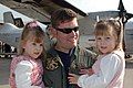 US Navy 051107-N-1658A-003 Officer-In-Charge, Fleet Logistics Support Squadron Three Zero (VRC-30), Detachment 3, Lt. Cmdr. Mike Biemiller, holds his twin daughters during the detachment's homecoming.jpg