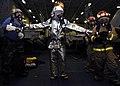 US Navy 060315-N-5837R-036 A scene leader escorts to hose teams into a simulated fire in the hangar bay.jpg