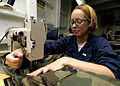 US Navy 060320-N-9079D-008 Aircrew Survival Equipmentman Airman Katherine S. Effle, sews battle dress uniforms (BDU) aboard the Nimitz-class aircraft carrier USS Abraham Lincoln (CVN 72).jpg