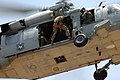 US Navy 060419-N-7293M-059 An explosive ordnance disposal technician assigned to the Royal Australian Navy prepares to rappel from an MH-60S Seahawk helicopter.jpg