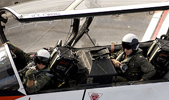 Tandem - Instructor and student pilots in a McDonnell Douglas T-45 Goshawk aircraft