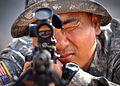 US Navy 061223-N-1328C-253 Army Sgt. Mijung Kim, from Harmon, Guam, uses a rifle scope to line up a target 300 meters away during joint training with the Marine Corps 5th Provisional Security Company.jpg