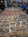 US Navy 070206-N-2880M-027 Air Traffic Controller Airman Shakeiva Jones, left, and Culinary Specialist Seaman Leonell Cruz prepare various deserts in the bake shop on board Nimitz-class aircraft carrier USS Harry S. Truman (CVN.jpg