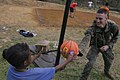 US Navy 070225-M-0455A-036 Cpl. Cody R. Waldroup hands a basketball to a Filipino child at the Subic Freeport Welfare Reservation, also known as the Aeta Resettlement.jpg