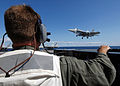 US Navy 070703-N-8923M-121 Landing signal officer (LSO) Lt. Brett Pugsley watches from the LSO platform as an F-A-18E Super Hornet prepares to land aboard Nimitz-class aircraft carrier USS Harry S Truman (CVN 75).jpg
