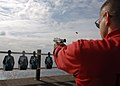 US Navy 070719-N-8132M-002 Chief Warrant Officer 2 Norman Gilbert, fires a 9mm handgun during small arms qualifications on the flight deck aboard nuclear-powered aircraft carrier USS Enterprise (CVN 65).jpg
