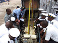 US Navy 071022-N-2559B-001 Engineman 2nd Class Kenneth A. Gosset leads a smallboat engineering tutorial aboard guided-missile destroyer USS Forrest Sherman (DDG 98) for members of the Congolese armed forces.jpg