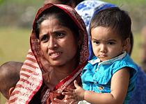 US Navy 071129-M-3095K-023 Mother and son patiently wait in line to receive medical aid in the wake of Tropical Cyclone Sidr that smashed into the southern coast of Bangladesh Nov. 15.jpg