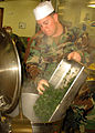US Navy 080121-N-8547M-055 Culinary Specialist 3rd Class Jesus D. Fimbres, assigned to Naval Mobile Construction Battalion (NMCB) 5, cooks vegetables for the Martin Luther King Jr. memorial dinner.jpg