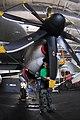 US Navy 080206-N-9760Z-014 Aviation Machinist Mate 2nd Class Merari Estrada cleans the propeller of an E-2C Hawkeye in the hangar bay of the nuclear-powered aircraft carrier USS Nimitz (CVN 68).jpg