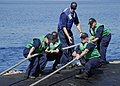 US Navy 080611-N-0780F-007 Sailors conduct mooring operations aboard the fast attack submarine USS Albany (SSN 753) as they arrive for a routine port visit.jpg