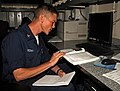 US Navy 080715-N-1786N-003 Storekeeper 2nd Class David Brown studies for a class provided by the Navy College for Afloat College Education program aboard the amphibious assault ship USS Tarawa (LHA 1).jpg