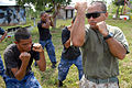 US Navy 090330-N-4143O-004 Cpl. Robert Ortega, a Southern Partnership Station instructor assigned to the Marine Corps Training and Advisory Group, shows a Nicaraguan Marine proper punching technique.jpg