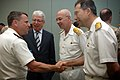 US Navy 090503-N-8053S-160 Vice Adm. Bill Gortney, Commander, Combined Maritime Forces, greets Turkish Navy Rear Adm. Caner Bener during a Combined Task Force (CTF) 151 ceremony in which Bener assumed command of the counter pir.jpg