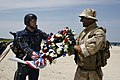 US Navy 090718-N-5366K-162 James Woods presents a wreath to a Navy SEAL from Naval Special Warfare Group (NSWG) 2 to honor fallen teammates.jpg