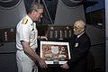 US Navy 090827-N-3038W-005 Rear Adm. John W. Miller, commander of Carrier Strike Group (CSG) 11, presents Nobuyuki Masuda, president of the Mikasa preservation association, a framed photo montage.jpg