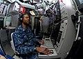 US Navy 100414-N-7179M-034 Sonar Technician (Submarines) 2nd Class Harlie Williams III, takes sonar readings aboard the Los Angeles-class attack submarine USS Newport News (SSN 750).jpg