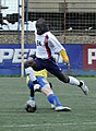 US Navy 100510-N-7478G-409 Personnel Specialist 3rd Class Ernest Baah jumps to avoid a Russian player trying to steal the soccer ball.jpg