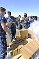 US Navy 100526-N-9643W-227 Sailors assigned to High Speed Vessel Swift (HSV 2) load Project Handclasp donations into vehicles on the pier for several organizations in Panama City, Panama.jpg