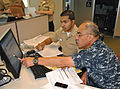 US Navy 100612-N-8374E-533 Chief Hospital Corpsman Hugo A. Castellanos, right, a Reserve Component member assigned to Operational Health Support Unit, Dallas, Detachment F.jpg