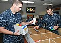 US Navy 101021-N-7282P-016 Sailors assigned to Commander, U.S. 3rd Fleet makecare packages for shipmates serving as individual augmentees.jpg