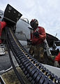 US Navy 110811-N-DS193-009 Aviation Ordnanceman 3rd Class Christian Jones, from Tampa, Fla., uses a speed wrench to load 20 mm high explosive incen.jpg
