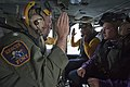 US Navy 110911-N-RR095-072 Cmdr. Michael Dowling, left, air boss aboard the amphibious assault ship USS Makin Island (LHD 8), administers the oath.jpg