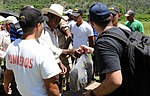 US troops hike over 4,000 pounds of food, supplies, clothing to Honduras village 140621-Z-BZ170-003.jpg