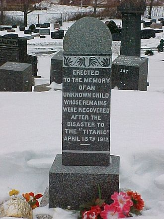The Unknown Child - The grave of the unknown child in Fairview Cemetery, in the winter.