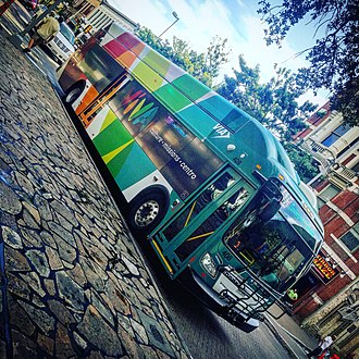 VIA Metropolitan Transit - An 11B VIVA Culture Bus travels along Alamo street in Downtown San Antonio, TX