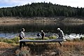 Volunteers place sunlight barriers here Oct. 31 as part of a project to eradicate invasive Eurasian milfoil plants from the lake bottom.jpg