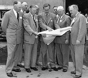 Disneyland - Walt Disney (center) showing Orange County officials plans for Disneyland's layout, December 1954.