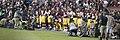 Washington Redskins National Anthem Kneeling (37301887651).jpg