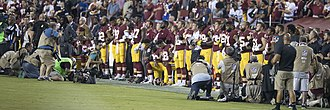 U.S. national anthem protests (2016–present) - Washington Redskins players kneeling before the game with the Oakland Raiders