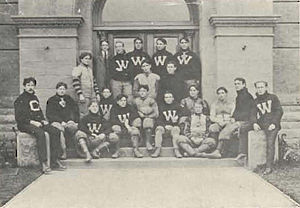 "William Namack - Washington football team, 1903, pictured in The Chinook 1904, Washington State yearbook. Namack is pictured at the left end of the last row (with the ""C"" sweater)."