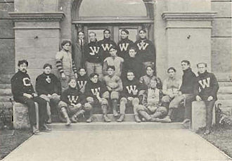"""William Namack - Washington football team, 1903, pictured in The Chinook 1904, Washington State yearbook. Namack is pictured at the left end of the last row (with the """"C"""" sweater)."""