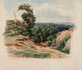 Hiekkaisella mäellä kulkeva tie