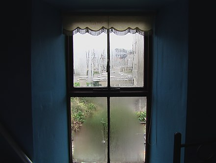 Condensation on a window during a rain shower. Window in Ireland.jpg