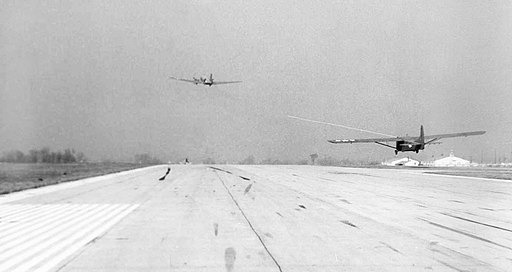 Winged Cargo Inc. Douglas C-47 takes off while towing a Waco CG-4A glider