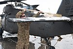 Wings of Destiny clean up after snow storm 130112-A-IA071-018.jpg
