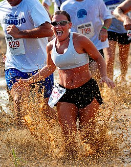 Woman runs through mud