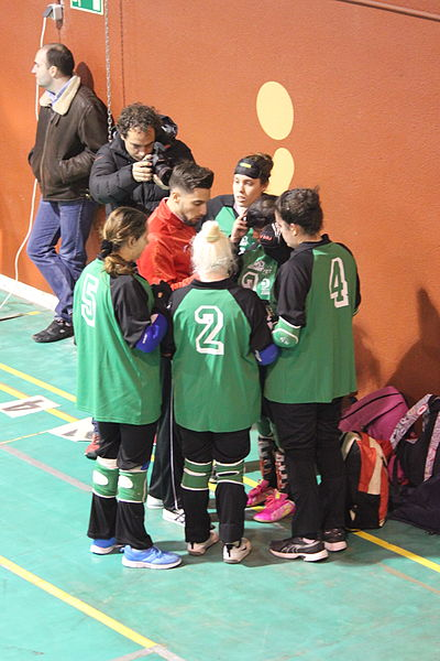 Goalball players in a group around coach.