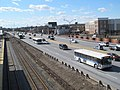 Worcester Line shuttle buses passing Boston Landing station, April 2017.JPG