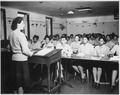 """U.S. Army nurses are taking notes during a lecture in (a) classroom at the Army Nurse Training Center in England."", 09- - NARA - 531411.tif"